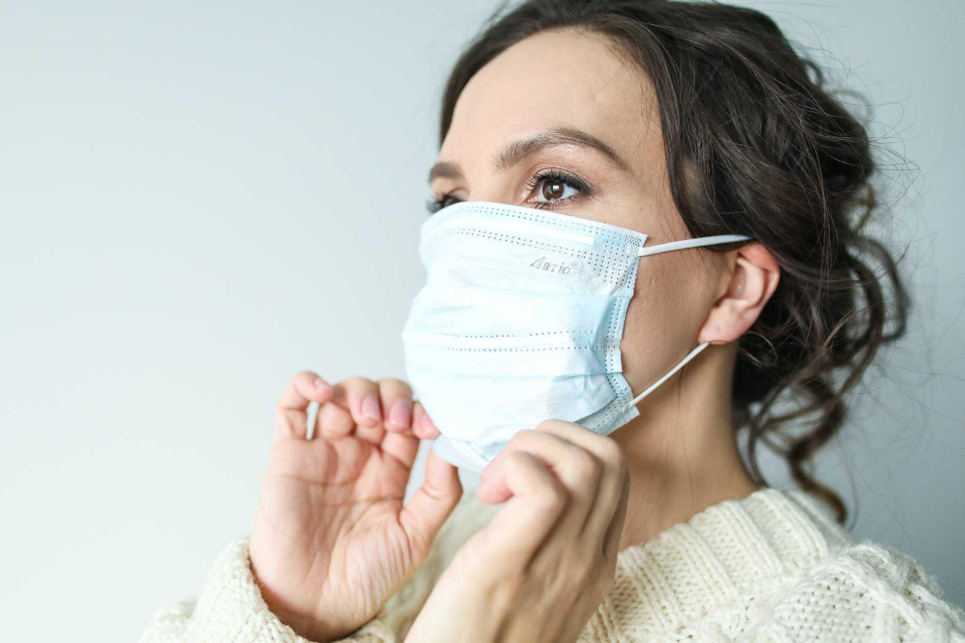 woman in white face mask
